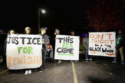 Demonstrators protest the killing of 19-year-old Renisha McBride outside the Dearborn Heights Police Station
