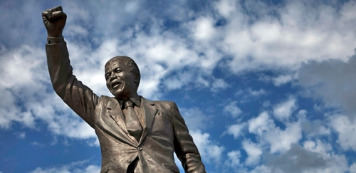 A statue of Nelson Mandela stands outside the gates of Drakenstein Correctional Centre (formerly Victor Verster Prison), near Paarl in Western Cape province. (Photo: Finbarr O'Reilly/Courtesy Reuters)
