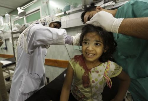 A displaced Palestinian taking shelter at a UN school receives treatment at the Kamal Edwan hospital in Beit Lahia in the northern Gaza Strip early on July 31st 2014. Mohammed Abed/AFP.