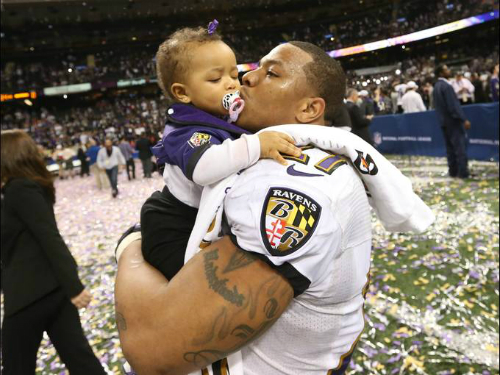 Ray Rice kisses his daughter Rayven after winning the Super Bowl in 2013.