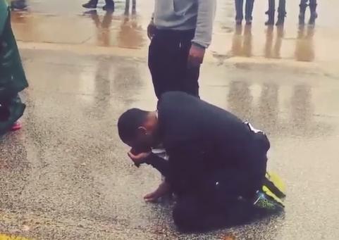 This man cries where Michael Brown was gunned down. He ran Atlanta to Ferguson.