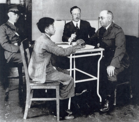 Young boy interrogated at Angel Island, 1910s.