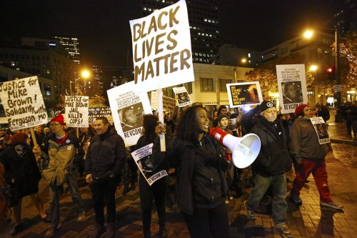 Seattle, Wa., November 24, 2014. About 100 people gathered at Westlake Park as the Ferguson, Mo. grand jury decision was announced then took to the streets in protest.